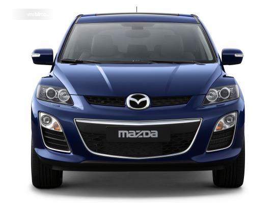 bagian depan Mazda CX-7 2009 dengan balutan krom di bagian sisi gril dan bezel fog lamp