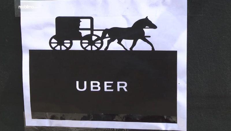 Gambar yang menunjukan logo Amish Uber dari Michigan