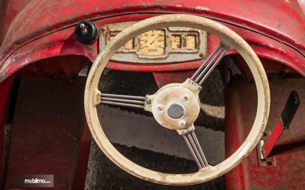 Gambar yang menunjukan bagian kemudi dari pedal car