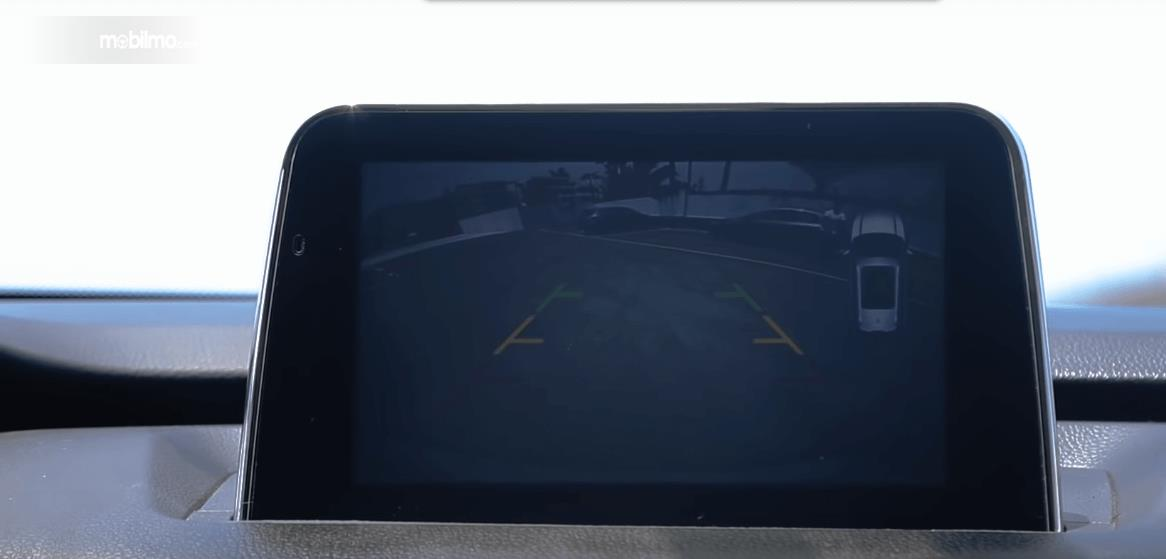 Gambar ini menunjukkan layar pada mobil DFSK Glory 560 2019 yang letaknya di bagian dashbboard
