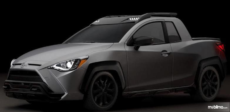 Gambar ini menunjukkan Render Toyota Yaris Pick Up dengan warna hitam dop