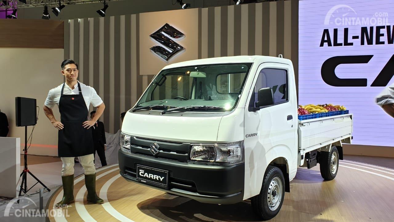 Gambar menunjukkan sebuah Mobil Suzuki Carry Pick Up 2019
