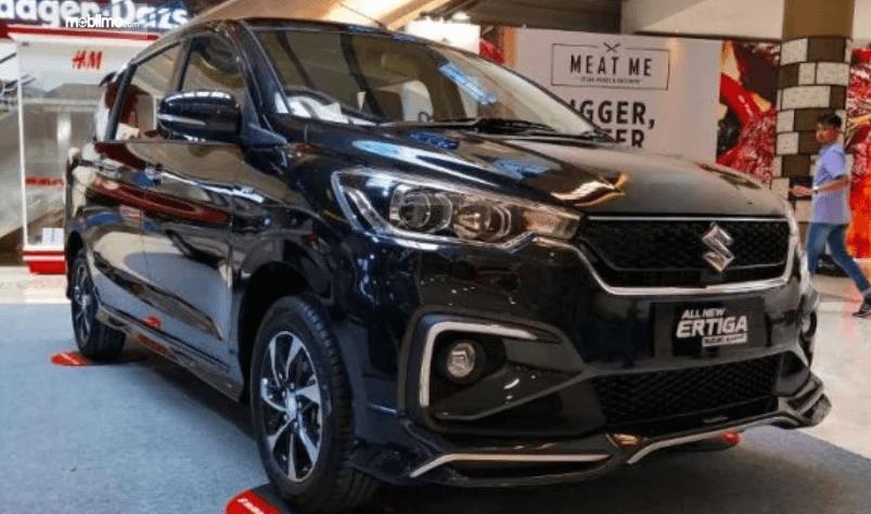 Gambar ini menunjukkan mobil All New Suzuki Ertiga warna hitam