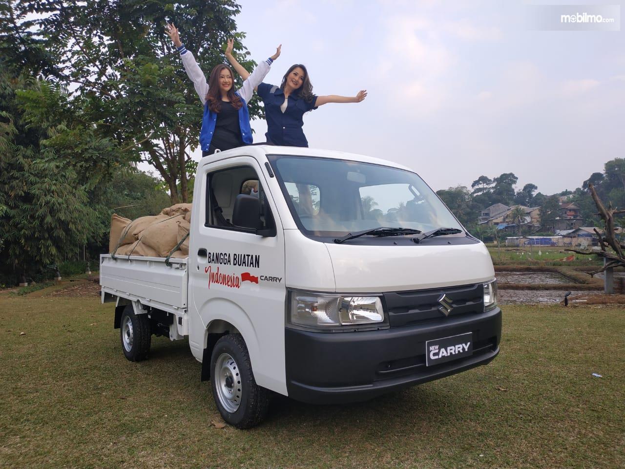 Gambar menunjukkan New Suzuki Carry Pick Up Wide Deck 2019 berwarna putih