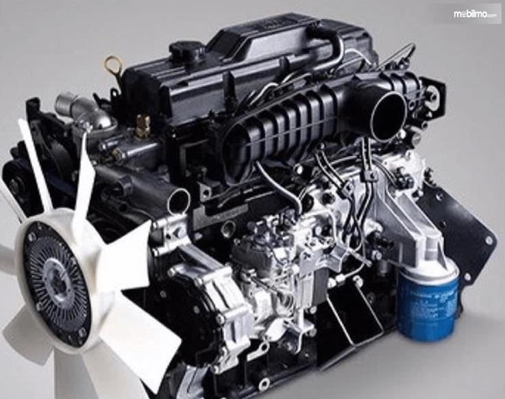 Gambar ini menunjukkan mesin mobil yang dimiliki KIA Travello 2006