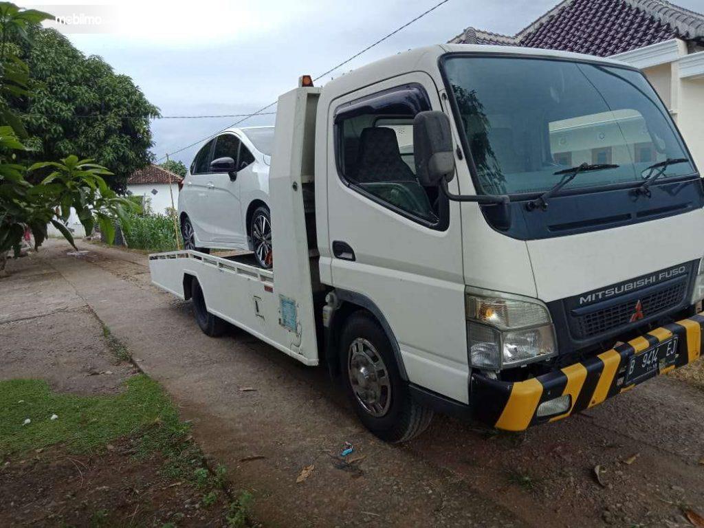 Foto menunjukkan Layanan towing Mitsubishi