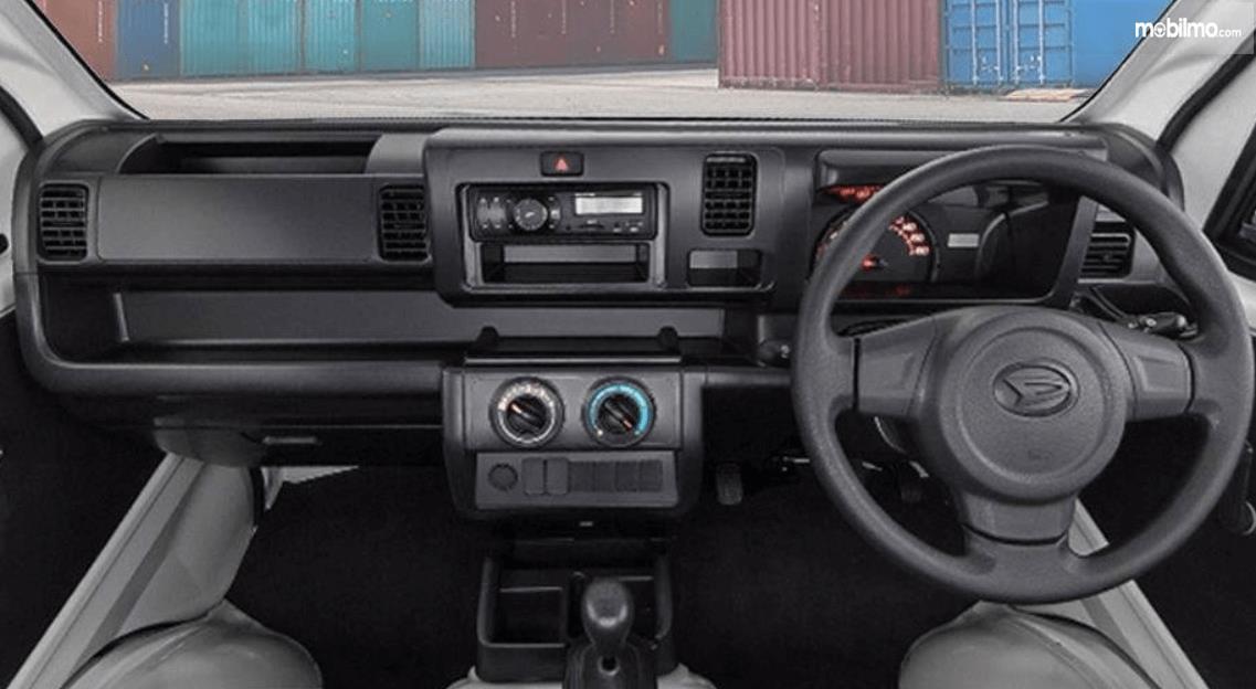 Gambar ini menunjukkan dashboard dan kemudi mobil Daihatsu Hi-Max PU 1.0 STD AC PS 2016