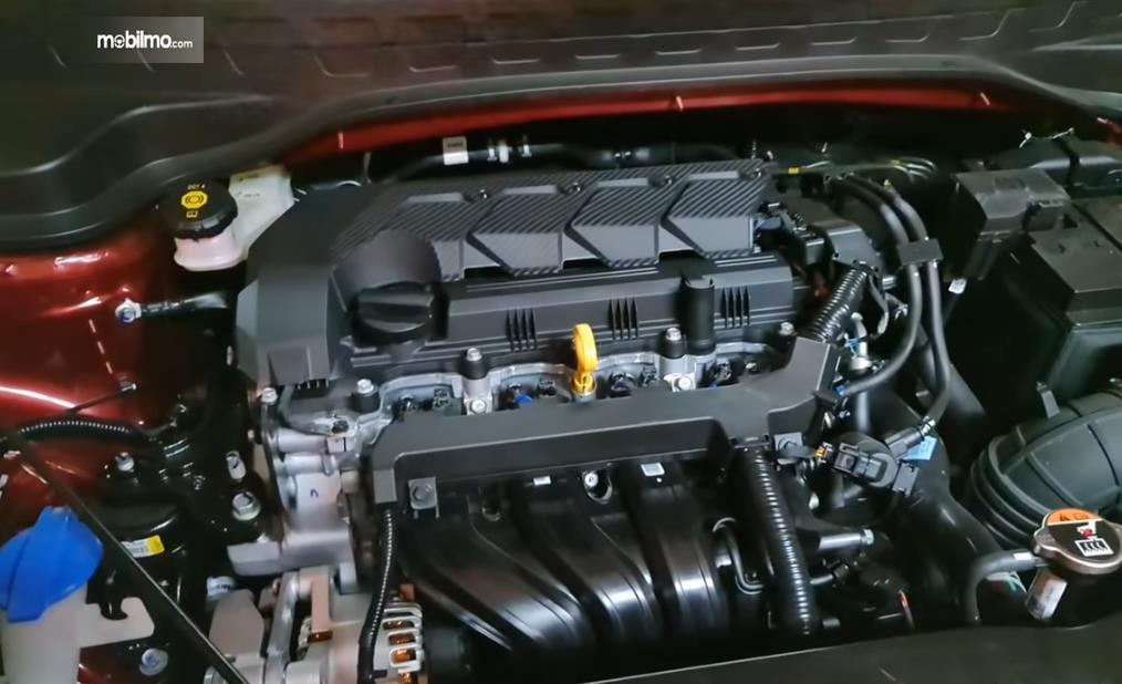Gambar ini menunjukkan mesin mobil KIA Sonet Premiere 7 Seater 2021